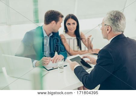 Business People On Meeting Discussing Conditions Of Future Contract