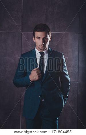 Portrait Of Handsome Successful Serious Businessman Wearing Black Suit