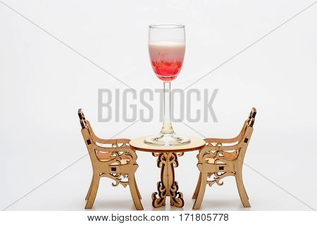Alcohol Coctail Singapore Sling On Decorative Table With Chairs
