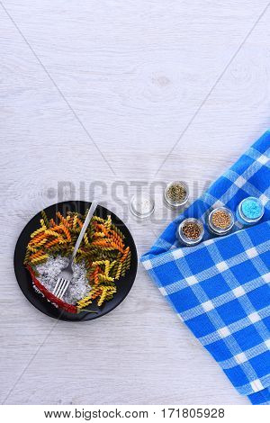 Plate With Pasta, Fork, Spices In Jars And Tablecloth Square