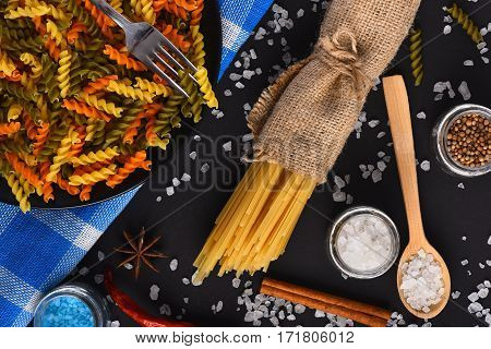 Dried Colorful Italian Pasta On Blue Plaid Tablecloth