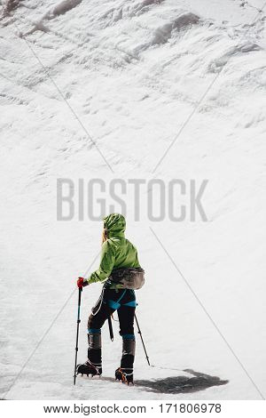 Traveler climbing to mountain summit Travel Lifestyle concept adventure active vacations outdoor mountaineering sport alpinism equipment crampons on glacier