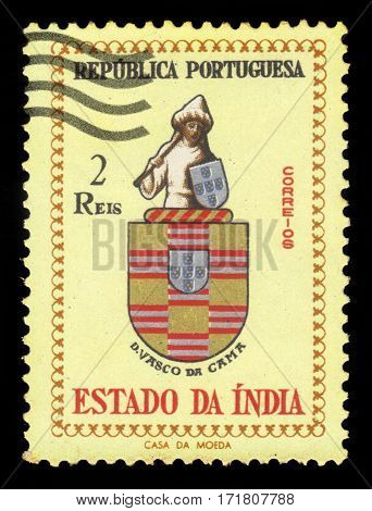 Portuguese India - circa 1959: A stamp printed in Portugal shows coats of arms of Vasco da Gama, 1st Count of Vidigueira, circa 1959