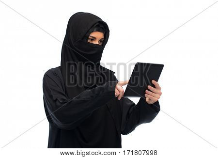technology and people concept - muslim woman in hijab with tablet pc computer over white background
