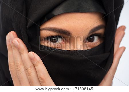 religious and people concept -  close up of muslim woman in hijab