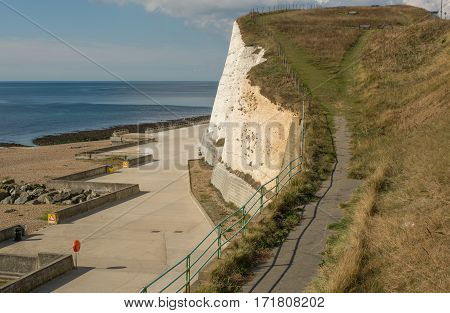 Seafront and shingle beach at Rottingdean near Brighton East Sussex England