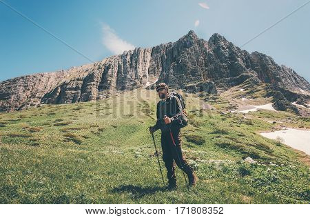Man traveler hiking in mountains Travel Lifestyle concept adventure active summer vacations outdoor
