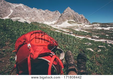 Red Backpack with rocky mountains on background Travel Lifestyle concept adventure active summer vacations outdoor hiking equipment