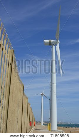 Wind Turbines on the harbour wall at Shoreham in West Sussex England