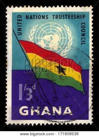Ghana - circa 1959: A stamp printed in Ghana shows Ghana flag and UN emblem, United Nations Trusteeship Council, circa 1959