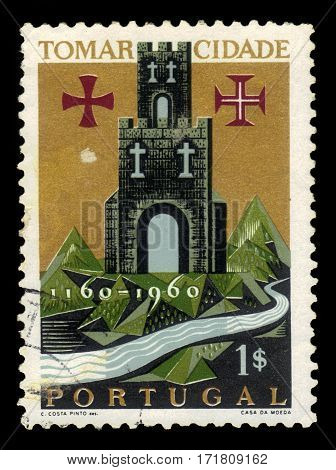 Portugal - circa 1962: A stamp printed in Portugal shows coat of arms of city of Tomar, city and a municipality in Santarem District, circa 1962