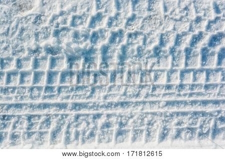 Vivid background of automobile traces in fresh snow