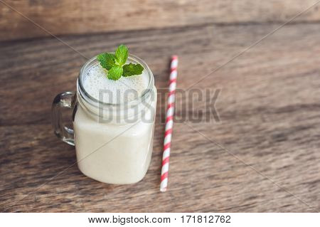 Banana Cocktail And Fresh Bananas On The Old Wooden Background