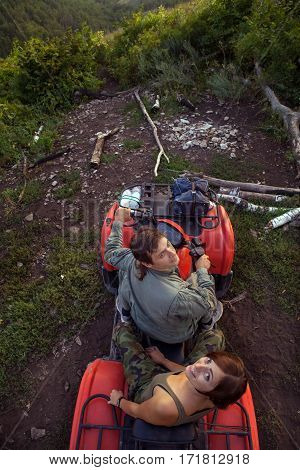 Man And Woman Are Making Selfie While Sitting On A Quadbike.