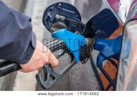 image of refueling a car with gasoline closeup