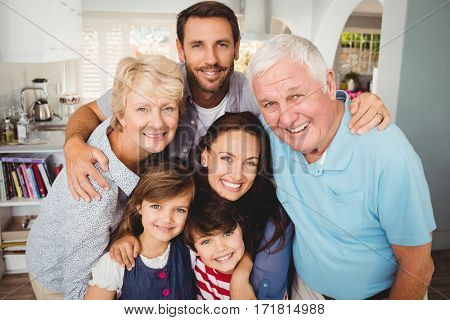 Portrait of smiling family with grandparents at home