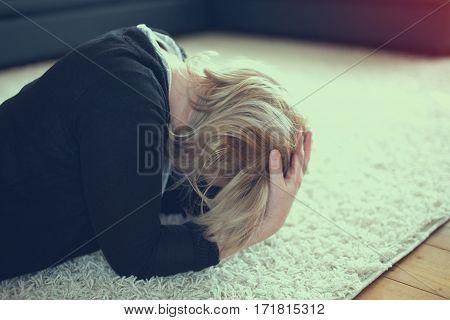 Woman got headache or fail on carpet vintage style