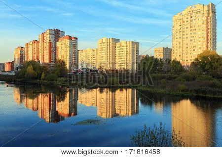 New residential district on the bank of the river Pekhorka during sunset. Balashikha, Moscow region, Russia