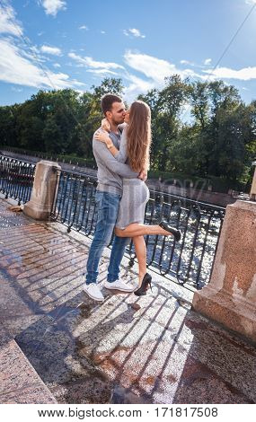 Fashion Of Nice Pretty Young Hipster Woman With A Handsome Man Embracing Her