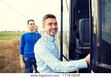 transport, tourism, road trip and people concept - group of happy male passengers boarding travel bus