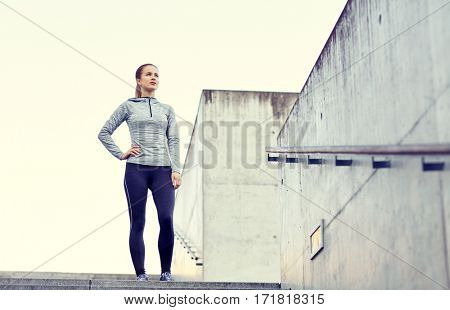 fitness, sport, people and lifestyle concept - sportive woman at city