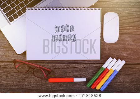Make Money Text On Wooden Desk With Tablet Pc And Keyboard.