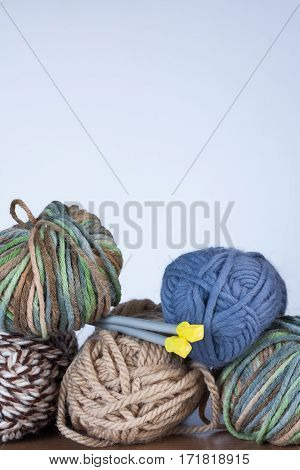 Close Up Of Threads For Knitting And Spokes On White Background Copyspace.