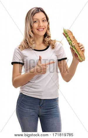Joyful woman holding a sandwich and pointing isolated on white background