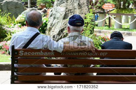People Relax At The City Park In Sunny Day