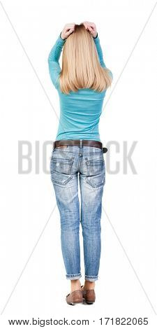 Back view of shocked woman in blue jeans. upset young blonde girl. Rear view people collection.  backside view of person.  Isolated over white background.