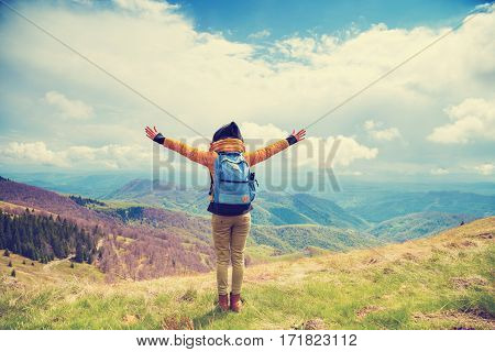 Girl enjoying in the nature with arms wide open.