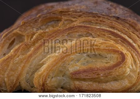 Layers of Croissant Pastry rolled up shows texture of the breakfast treat