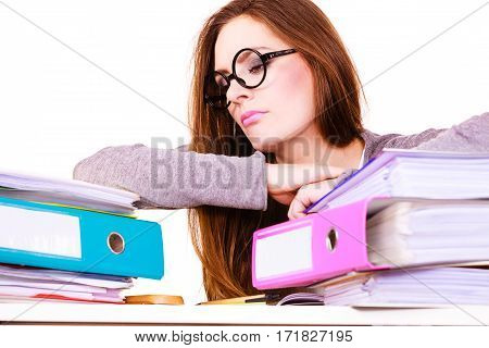 Woman working in office. Young overworked businesswoman or distressed secretary with a lot of documents folders bills on her desk. Business and paperwork. Studio shot on white.