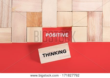 Wooden cube with a word POSITIVE THINKING