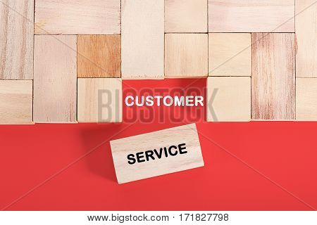Wooden cube with a word CUSTOMER SERVICE