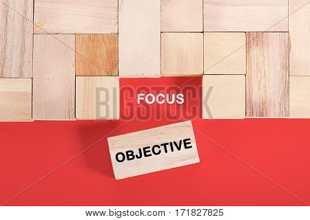 Wooden cube with a word FOCUS OBJECTIVE