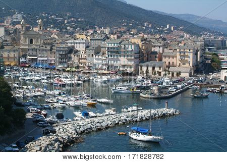 Bastia, France - 16 July 2006: boat crusing in front of the old citadel of Bastia on Corsica island