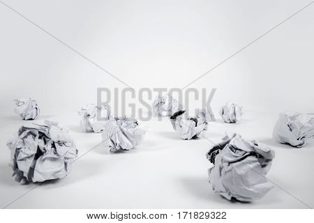 Crumpled balls of paper on white back ground.