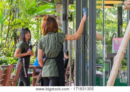 Asia Staff Women Cleaning By Wipe A Glass