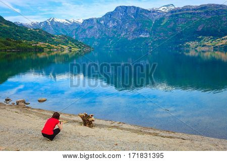 Tourist Taking Photo At Norwegian Fjord