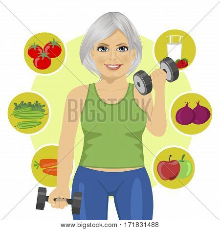 sporty elderly woman with dumbbells and variety of healthy vegetables