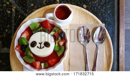 Sweet fruity pudding dessert, panda face decorated.