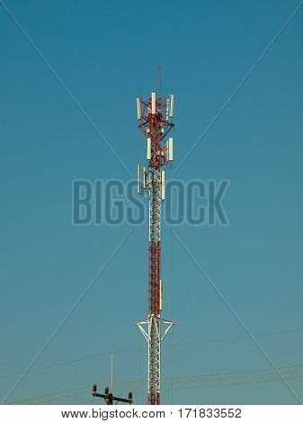 Telecommunication tower Antenna with the sky background.