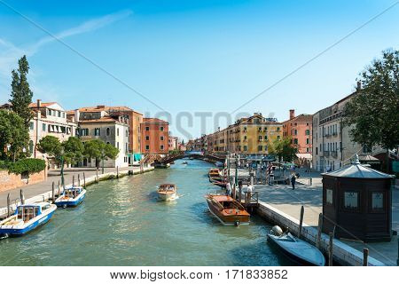 VENICE, ITALY - June 30, 2016. View of water street and old buildings in Venice. its entirety is listed as a World Heritage Site, along with its lagoon.June 30, 2016 VENICE, ITALY