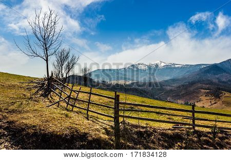 Wooden Fence Along The Path In Mountains