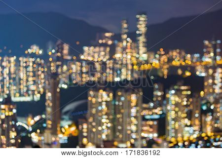 Night blurred bokeh Hong Kong residence building over high hill abstract background