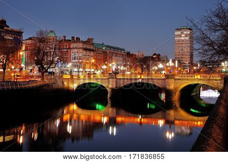 DUBLIN, IRELAND - DEC 28: O'Connell Bridge over the river Liffey in Dublin City Centre at night on Dec 28, 2016 in Dublin, Ireland. Built between 1791 and 1794, it is 45 meters long and 50 wide