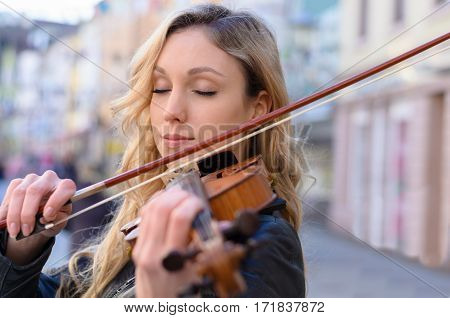 Woman Violin Player While Eyes Closed