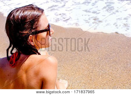 yong woman after sweeming in sea on the beach have a tan