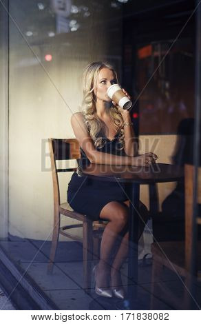 Elegant blonde woman drinking coffee preparing for work or interview. Nervous busy coffee addict.
